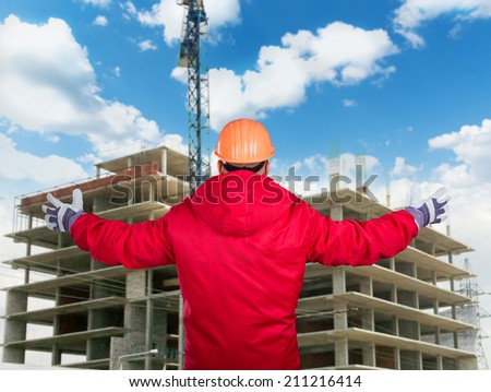 Builder at work with concrete construction - stock photo