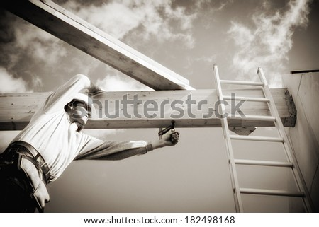 builder at work with on construction site - stock photo