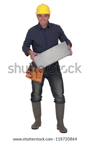 Builder carrying breeze block