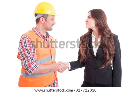 Builder constructor and business woman shaking hands as partnership and teamwork concept isolated on white background - stock photo