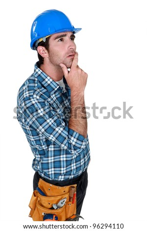 Builder deep in thought - stock photo