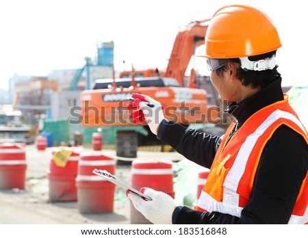 Builder engineer wearing safety work on location construction  - stock photo