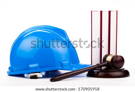 builder helmet , gavel and law books isolated on white - stock photo