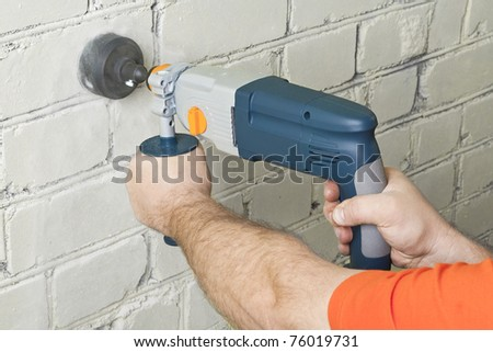 Builder hold perforator and drilling brick wall