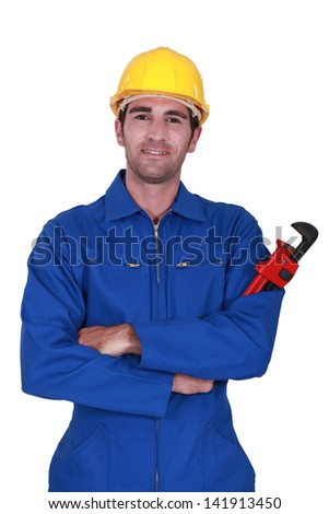 Builder holding red wrench - stock photo