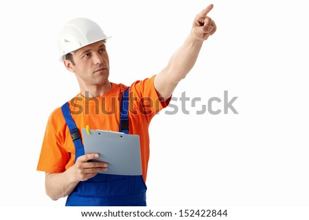 Builder in helmets on a white background - stock photo