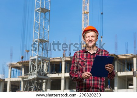 Builder in the orange helmet