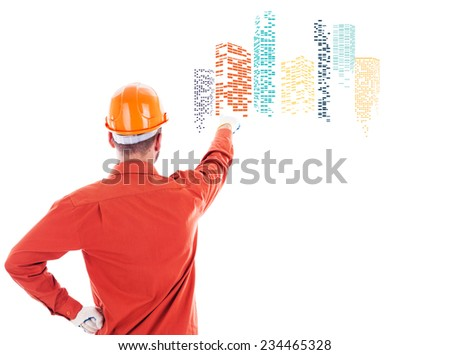 Builder pointing at graphic city icon with skyscrapers - stock photo