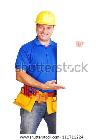 Builder pointing to the blank board - stock photo