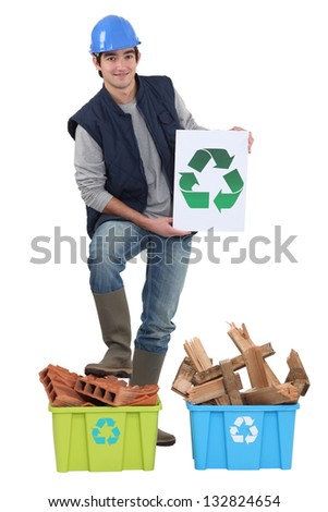 Builder recycling old material - stock photo