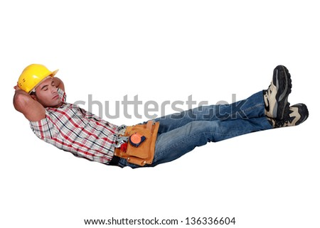 Builder sleeping - stock photo