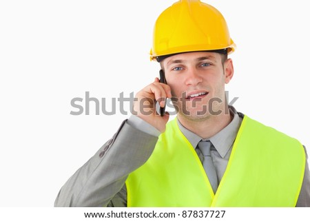Builder using his cellphone against a white background