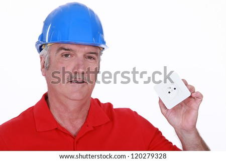 Builder with a continental power socket - stock photo