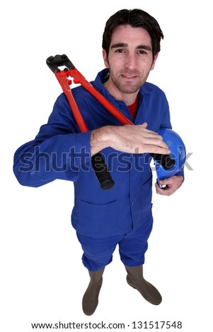 Builder with a pair of bolt cutters