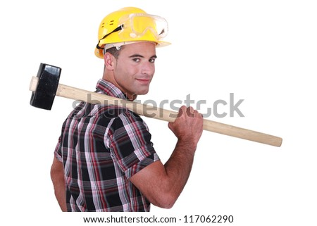 Builder with a sledgehammer - stock photo