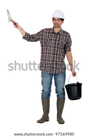 Builder with a trowel and a bucket - stock photo