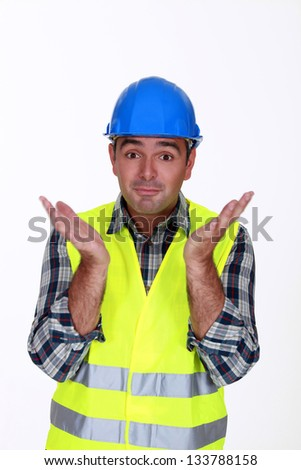 Builder with confused look on face - stock photo