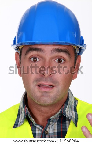 Builder with confused look on his face - stock photo