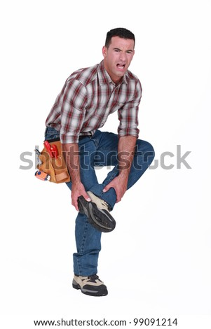 Builder with foot injury - stock photo