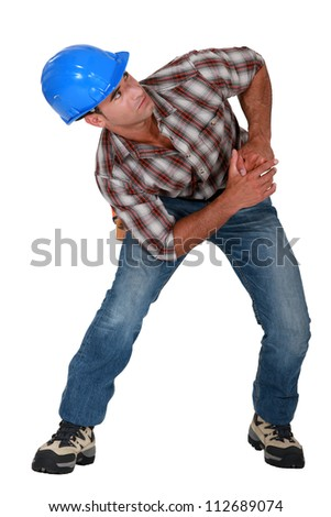 Builder with muscular pain - stock photo