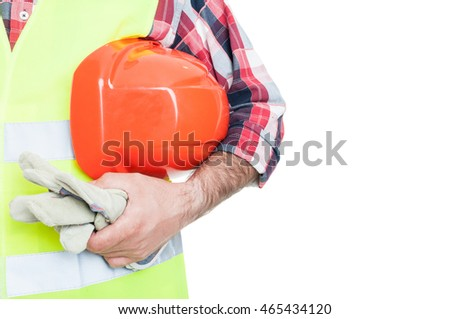 Builder with orange helmet and working gloves in closeup isolated on white background with text area