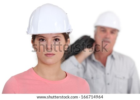 Builder with young female student - stock photo