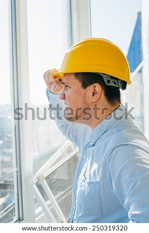 Builder worker activity looking out the window