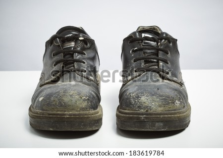 Builders safety shoes isolated on white background. DIY protection concept - stock photo
