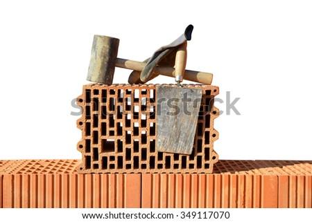 Building a brick wall. Bricklaying work. - stock photo
