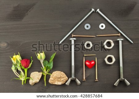 Building a house for the family. Needed for building. Building components. Screws and tools for building. Planning for the construction of the house. Model House of components.  - stock photo