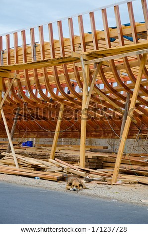 building a wooden ship on the street near the road - stock photo