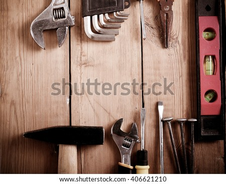 Building and repair tools on wooden background