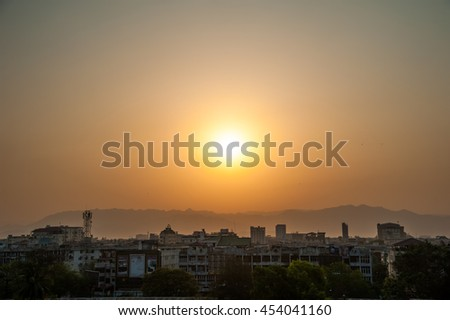 Building and sunset in Mandalay, Myanmar