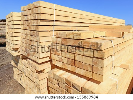 Building bar from a tree and an edging board in stacks - stock photo