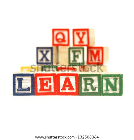 Building blocks to the steps of learning the basics of the english language. - stock photo