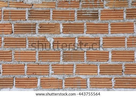 Building brick block wall on construction plant - stock photo