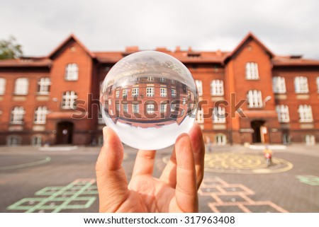 Building brick in glass ball - stock photo