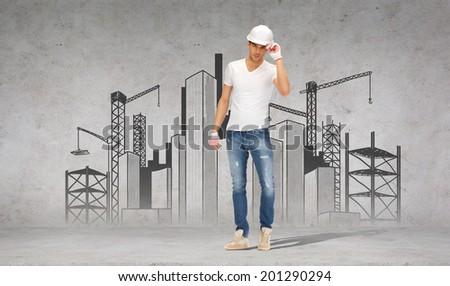 building, construction and renovation concept - handsome builder in helmet and gloves - stock photo