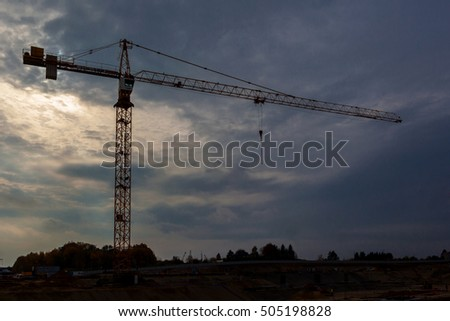 Building construction site at sunset