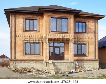 Building & Construction Site in progress to new house. Structure of house in construction. - stock photo
