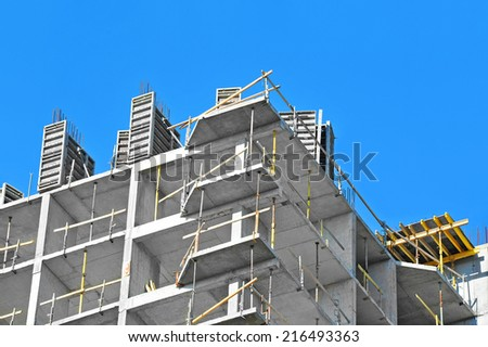 Building construction site work against blue sky