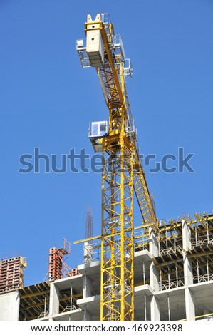 Building construction site work/ Building with crane