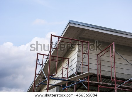 Building construction with scaffold - stock photo