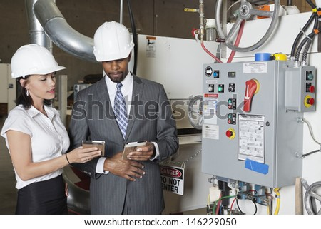 Building contractors in timber factory - stock photo