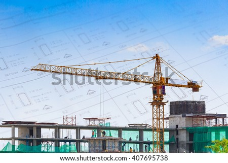 Building crane and construction site under blue sky with drawing background - stock photo
