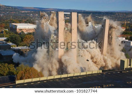 Building demolition by implosion - image 8 of a 10 shot sequence - stock photo