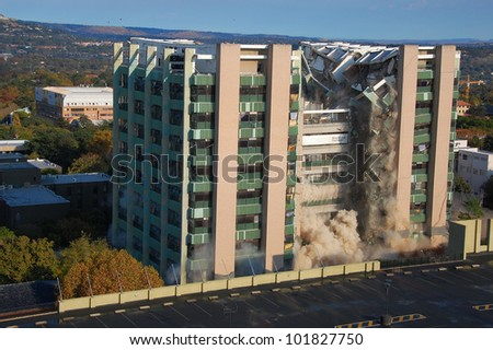 Building demolition by implosion - image 4 of a 10 shot sequence - stock photo