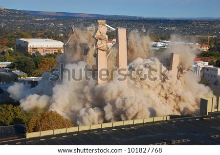 Building demolition by implosion - image 9 of a 10 shot sequence - stock photo
