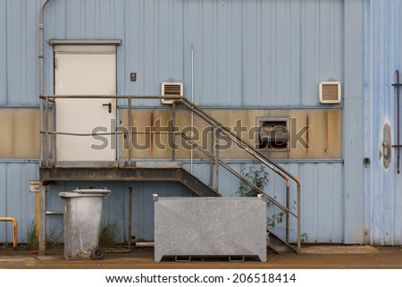 Building detail at an old industrial facility. - stock photo