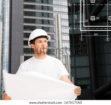 building, developing, construction and architecture concept - male architect in helmet looking at blueprint